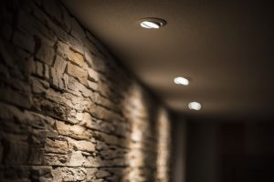 brick-wall-with-recessed-lighting-shining-on-it