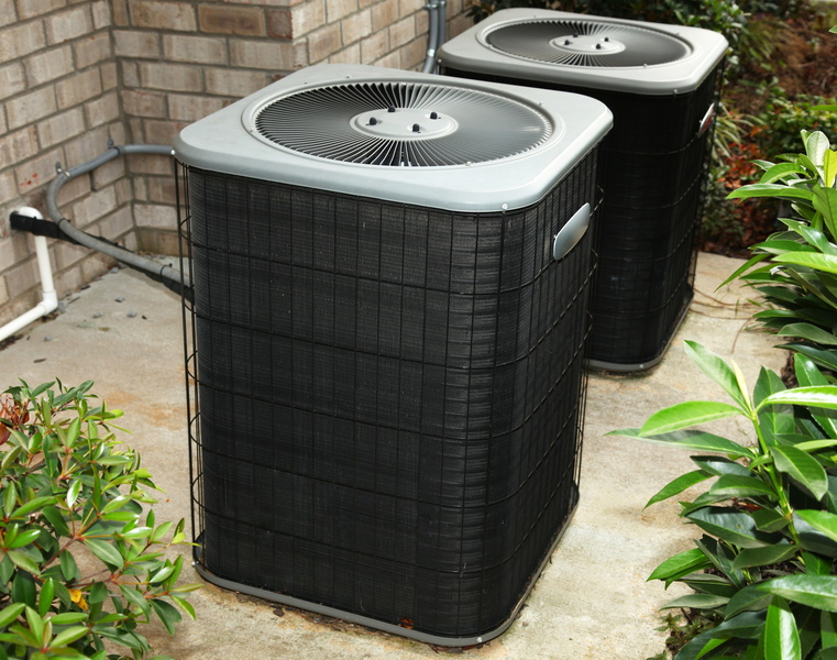 two-outdoor-ac-units-with-power-and-refrigerant-line-showing