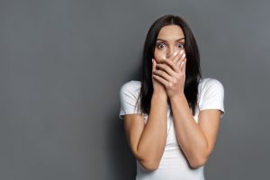 startled-woman-covering-her-mouth