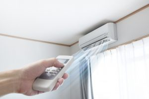 ductless-unit-with-remote-in-hand