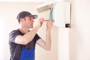 hvac-technician-installing-ductless-air-handler