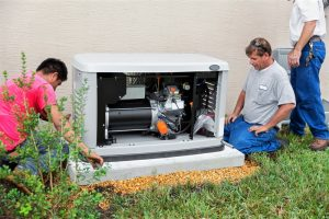 three-technicians-working-on-generator