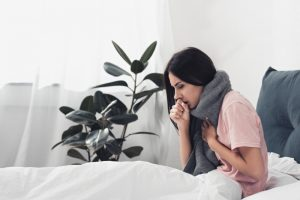 woman-coughing-in-bed
