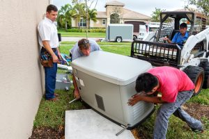 professionals-installing-whole-house-generator