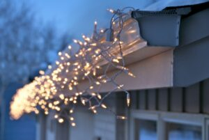 house-gutter-with-holiday-lights-on-it